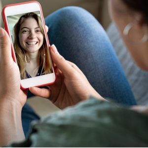 young-woman-using-smartphone-for-video-call-picture-id1163987892